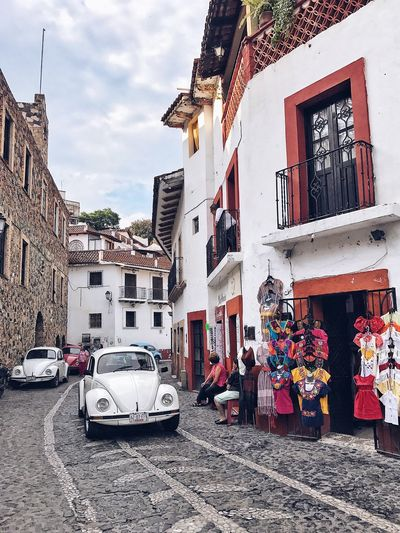 I officially declare Taxco the capital of Volkswagen Beetle, White Volkswagen Beetles. Streetphotography Travel Destination Culture White Houses Old Street Stone Road Car Architecture Transportation Land Vehicle Mexican Architecture Rural Scenes Village Old Town Old Mexican Town Beetle Beetle Car Volkswagen Volkswagen Beetle The People's Car Volkswagen Type 1
