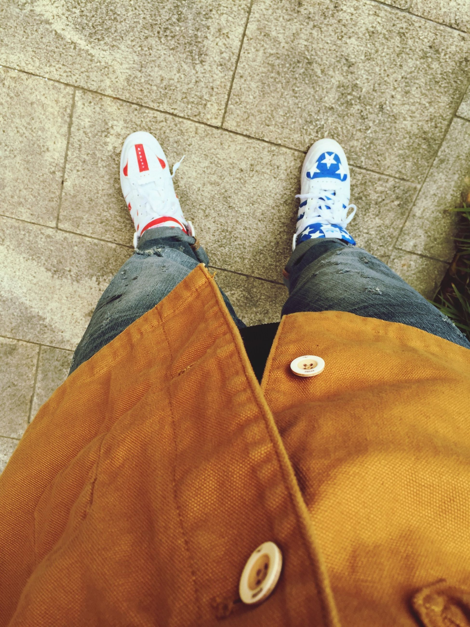 low section, person, shoe, jeans, lifestyles, standing, footwear, high angle view, human foot, casual clothing, personal perspective, leisure activity, canvas shoe, close-up, men, directly above, denim