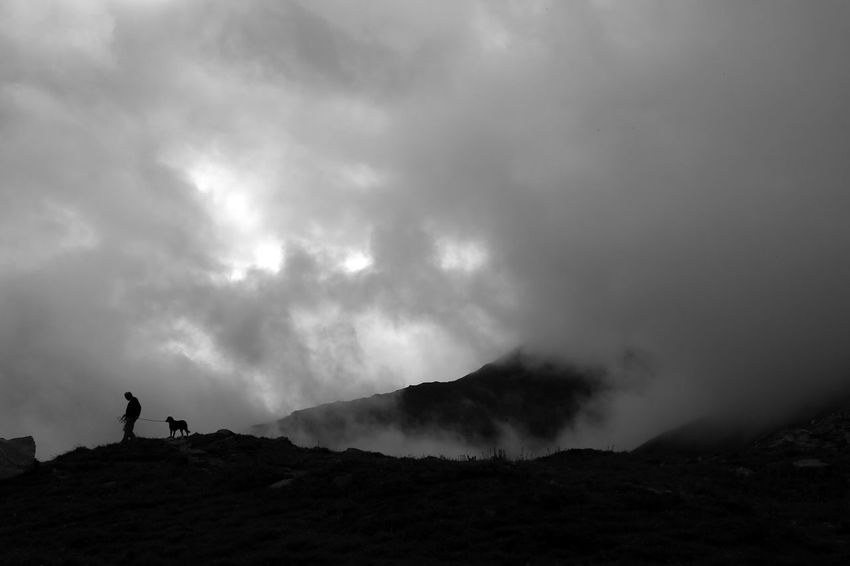 EyeEmNewHere Silhouette Mountain One Person Real People Danger Hiking Nature Sky Landscape Adventure Outdoors Beauty In Nature Leisure Activity Day Men RISK Cloud - Sky Scenics Power In Nature Full Length Black & White Blackandwhite Blackandwhite Photography Lifestyles The Week On EyeEm