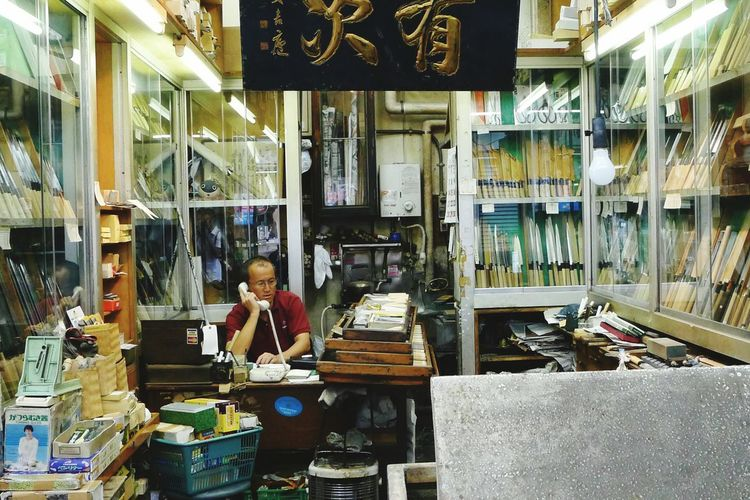 Man selling knives, Tokio. Sitting Indoors  Person Fresh On Eyeem  Selling Knivesfever Knives For Sale Knives Shop Shop Tokio Japanese Culture Japanese Traditional Travel Photography Travel Destination Travel