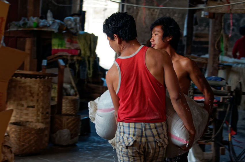 Traveling in the Shan state of Myanmar, Factory worker Nikon Shan State Adult Day Indoors  Lifestyles Men Myanmar People Real People Rear View Standing Togetherness Two People Young Adult Young Men Young Women