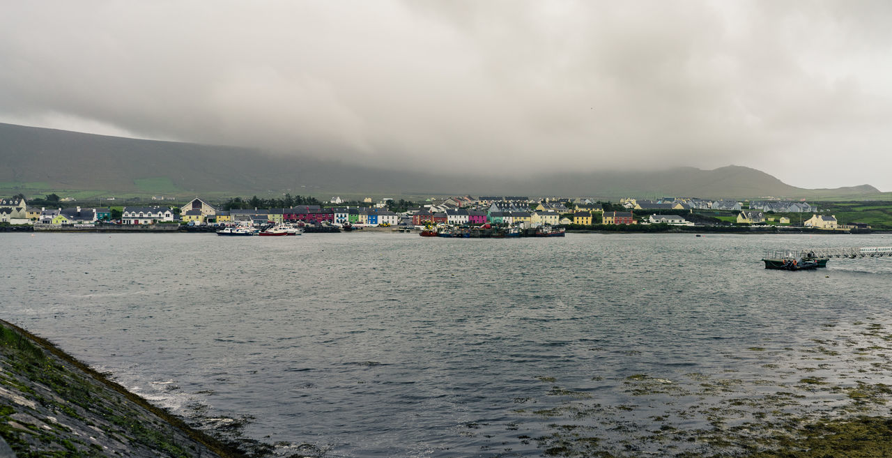 Portmagee Beauty In Nature Boat Calm Cloud - Sky Colorful Day Distant Ireland Mountain Nature Nautical Vessel Outdoors Portmagee Scenics Sea Seascape Ship Sky Tranquil Scene Tranquility Travel Destinations Vacations Village Water Waterfront