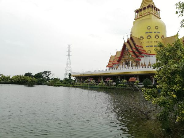 Thai Temple Thai Culture Buddhist Temple Water Tree City Sky Architecture Building Exterior Built Structure Pagoda Riverbank Stupa Buddhist Temple Temple - Building Buddhism Eaves Waterfront