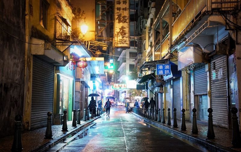 Rain Series Silouette Neon Lights Night Lights Streetphotography Streetphotography Rain Macau, China City Architecture Street Building Exterior The Way Forward Built Structure Illuminated Direction Lighting Equipment Night Group Of People Footpath City Life Walking Men Wet Outdoors