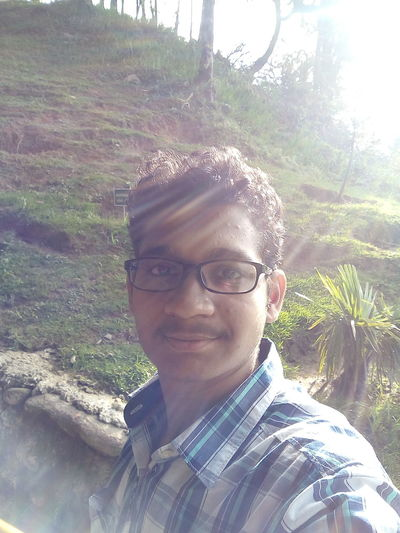 Portrait One Person Headshot Eyeglasses  Looking At Camera Day Smiling Young Adult Outdoors Happiness Tree Nature Close-up Sunlight Through Trees Travel Photography Been There. Tea Crop Tranquility No People Evening Photography Travel Dairies Sikkim@India EyeEmNewHere Love Yourself