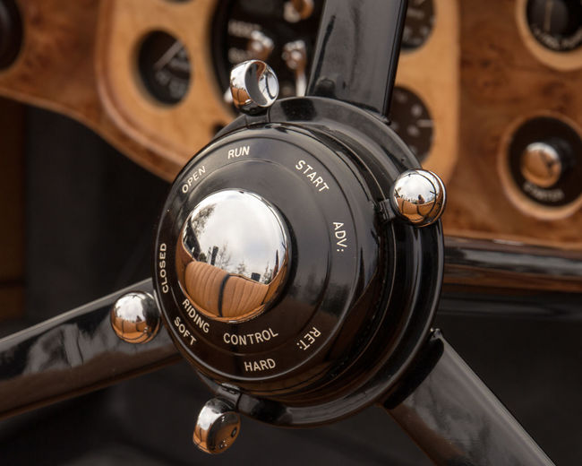 Close-up of vintage car steering wheel