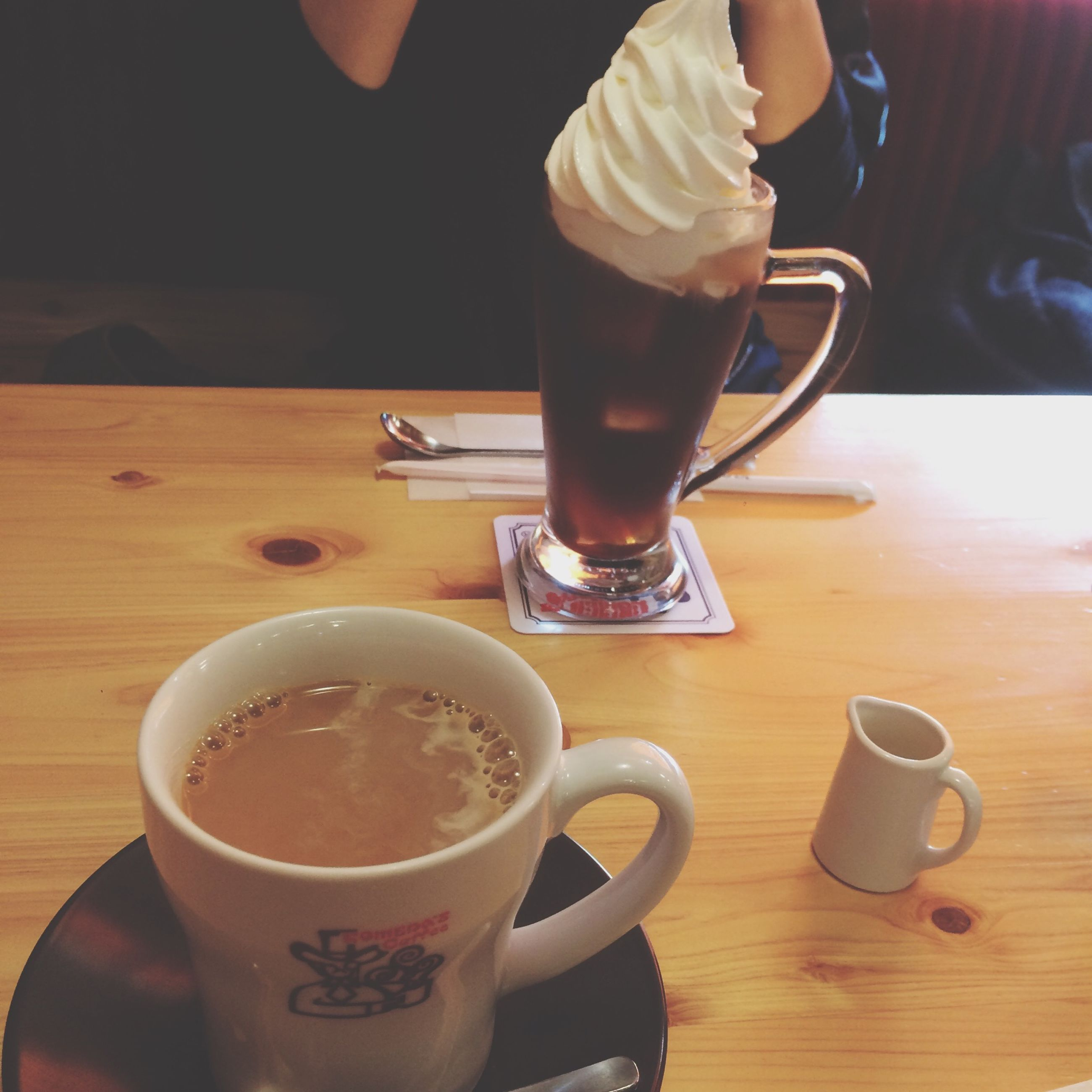 drink, food and drink, refreshment, table, coffee cup, indoors, coffee - drink, freshness, coffee, lifestyles, frothy drink, drinking glass, cup, person, leisure activity, close-up, saucer