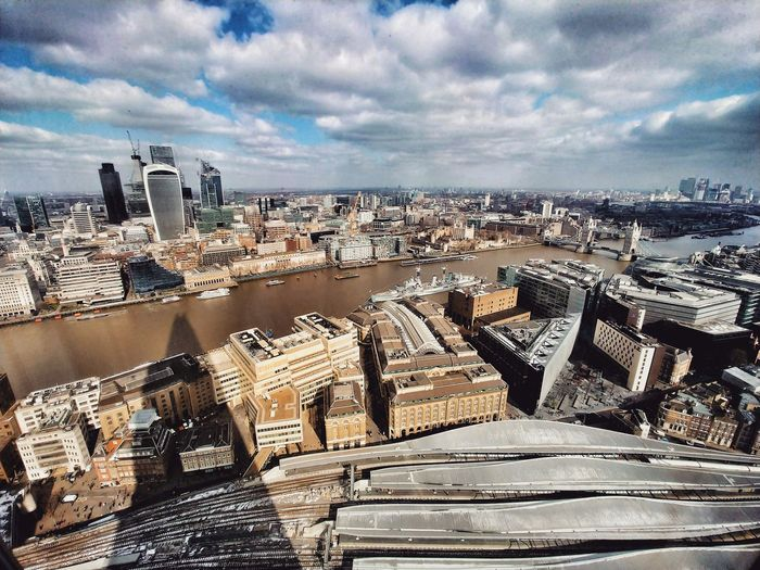 High angle view of buildings against cloudy sky