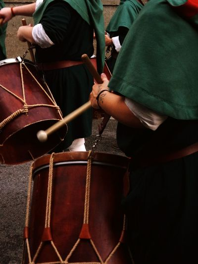 Midsection Of People Playing Drums On Street During Medieval Festival
