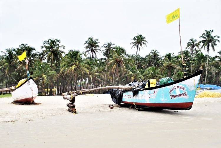 Goa ...Sand & the Sea Colva Beach India Fun Beach Goa India Sand & Sea Boats Docked Fishing Boat Yellow Flag