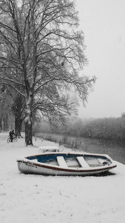 'Munchkin in the Snow' Rowing Boat Winter_collection Rowing Derelict Boat River Riverside Exceptional Photographs Bike Cyclist River View River Severn Tree No People Day Outdoors Nature Bare Tree Winter Snow Beauty In Nature