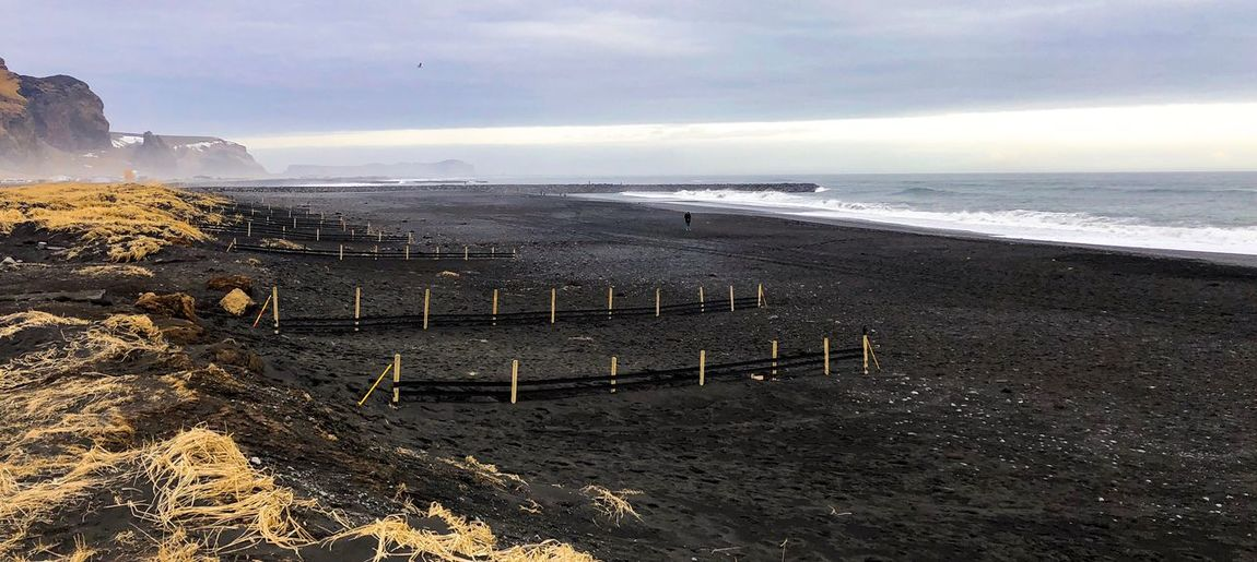 black beach, Vík, Iceland Sand Black Sea Nature Beauty In Nature Scenics Tranquility Sky Water Tranquil Scene Outdoors Horizon Over Water Day No People Mountain Beach