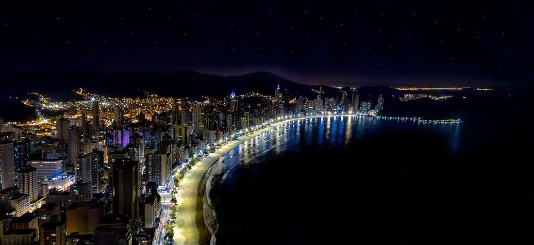 Aerial view of balneário camboriú waterfront lit up at night
