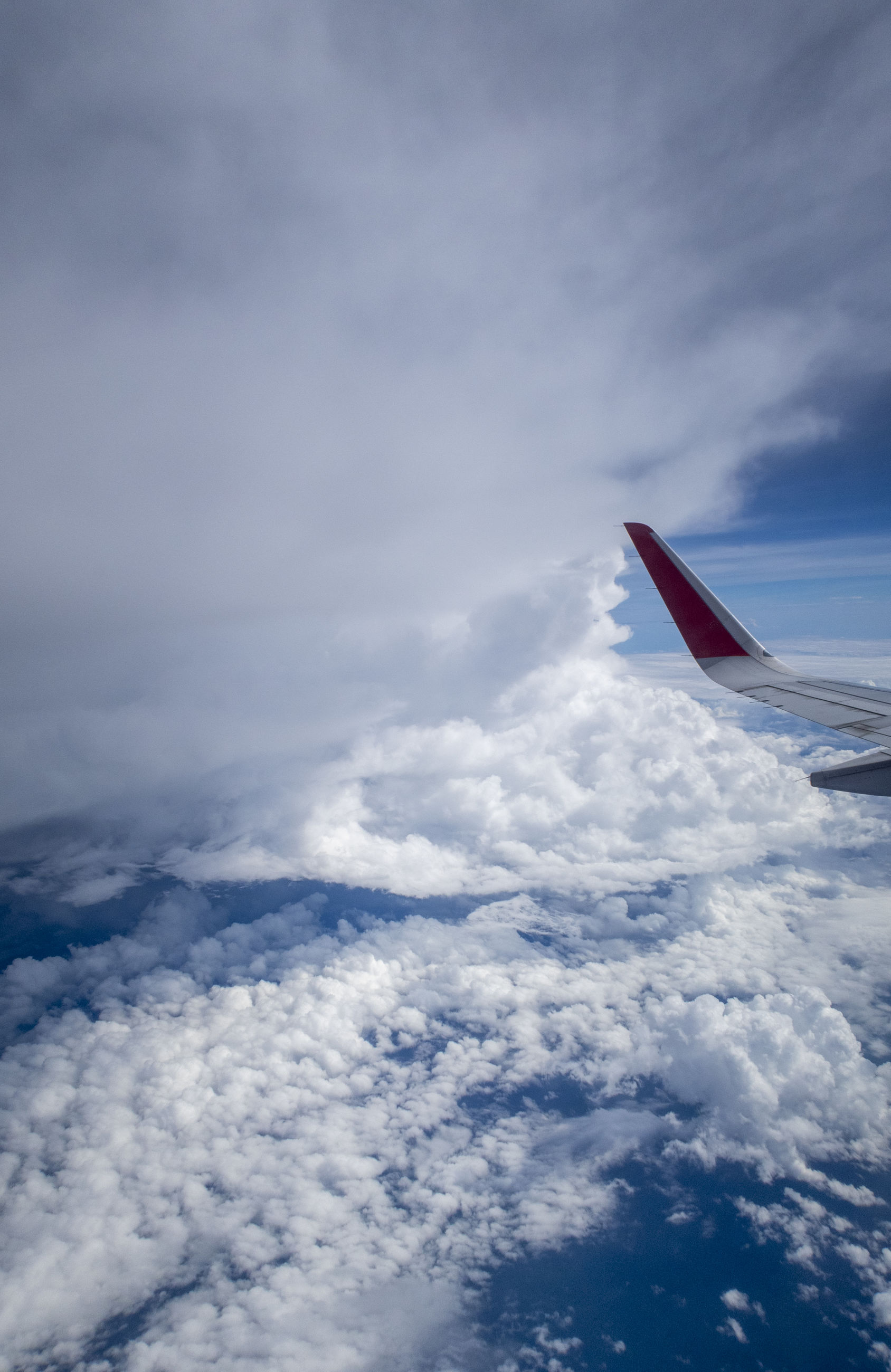 AERIAL VIEW OF CLOUDSCAPE OVER AIRPLANE