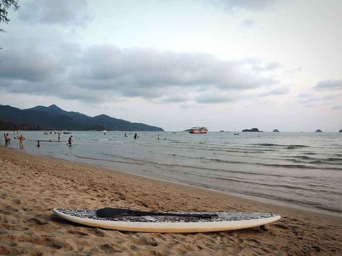 Surfboard for rent.. Sand & Sea Boats⛵️ Clouds And Sky Skyline Thailand HelloEyeEm Tree Awesome Sea Beach Water Land Sky Sand Nature Beauty In Nature Scenics - Nature Nautical Vessel Travel Cloud - Sky Mountain Travel Destinations Bay Landscape Holiday Outdoors Tranquility