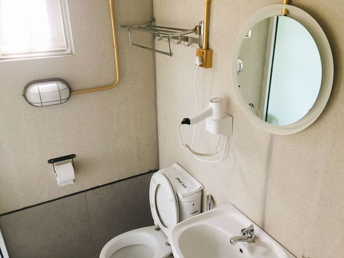 High Angle View Of Sink And Toilet