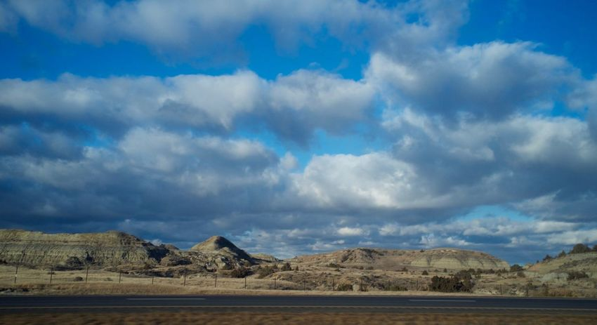 2-7-16 Arid Climate Beauty In Nature Cloud Cloud - Sky Cloudy Dusk Exploring Geology Geometry Horizontal Symmetry No People North Dakota Orange Color Outdoors Overcast Physical Geography Remote Scenics Silhouette Sky Sunset Symmetry Tranquil Scene Tranquility Western North Dakota