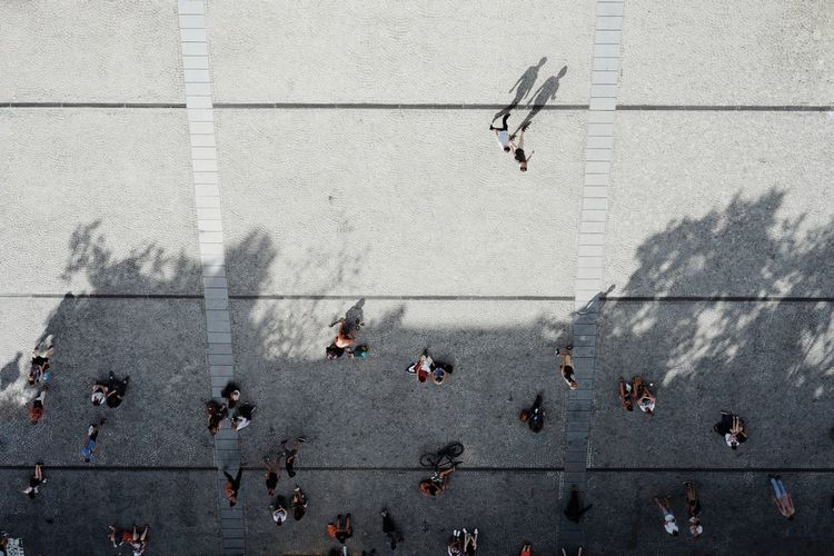 Directly Above Shot Of People On Footpath