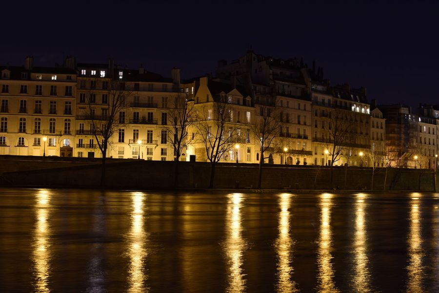 Along The Riverside River Seine Paris Nightphotography Night Building Exterior Architecture Outdoors Illuminated No People Politics And Government Cityscape City Water Sky