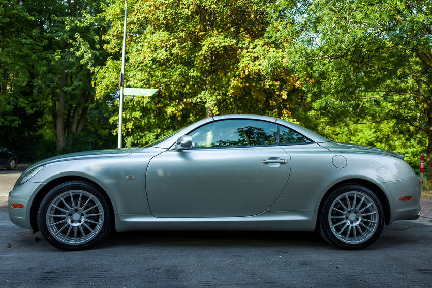 Lexus SC 430 SC430 Car City Day Green Color Growth Land Vehicle Metal Mode Of Transportation Motor Vehicle Nature No People Outdoors Plant Retro Styled Silver Colored Stationary Transportation Travel Tree Vintage Car Wheel