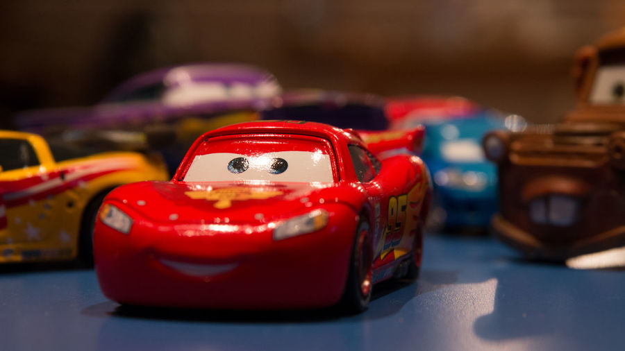 Cars Close-up Focus On Foreground Lightning Lightning Mcqueen Machine Part No People Red Selective Focus Still Life Toy Car