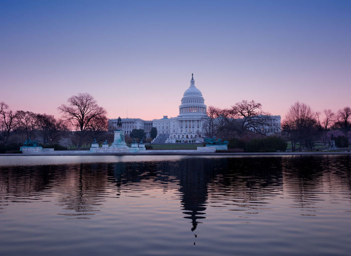 Sunrise at the US Capitol building in the capital city of Washington DC in the USA Capitol DC Government Reflection Skyline US Capitol US Capitol Building USA Washington Washington DC Washington, D. C. Capital Congress Dawn Dome Lake No People Pool Reflecting Pool Sunrise