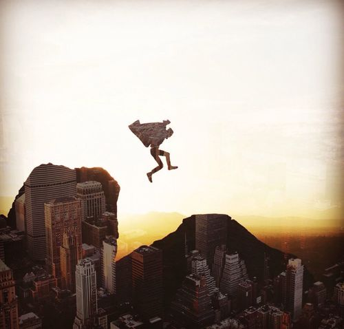 Break your Limits. Sunset Mid-air Jumping Silhouette Men Outdoors Full Length Architecture Extreme Sports Sky City Day People