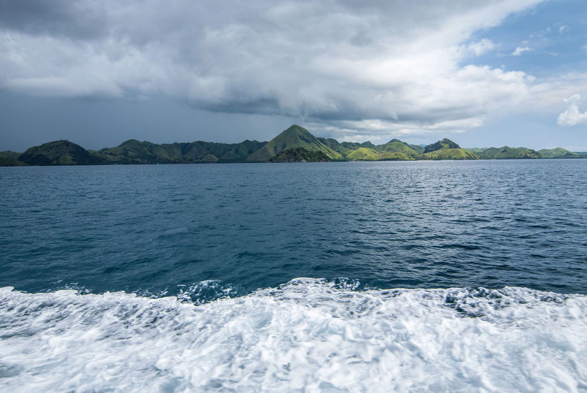 The Hill at the one of island at Komodo Archipelago with cloudy sky Beauty In Nature Blue Cloud - Sky Day Flores Idyllic Motion Mountain Nature No People Non-urban Scene Outdoors Pulau Komodo Remote Scenics - Nature Sea Sky Tranquil Scene Tranquility Water Waterfront