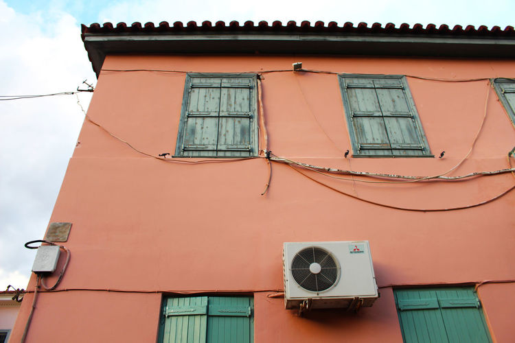 Architecture Athens Athens, Greece Building Building Exterior Built Structure Day Electric Wire Exterior Greece Low Angle View No People Orange Peach Residential Building Residential Structure Shutters