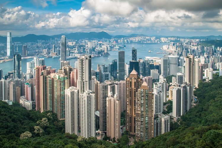 #Hong Kong #asia #cityscape #clouds  #hongkong #horizon #travel #urban Scene The Week On EyeEm Architecture Building Exterior Built Structure City Cityscape Crowded Day Downtown District Modern Mountain Office Park Outdoors Sky Skyscraper Tree Urban Skyline