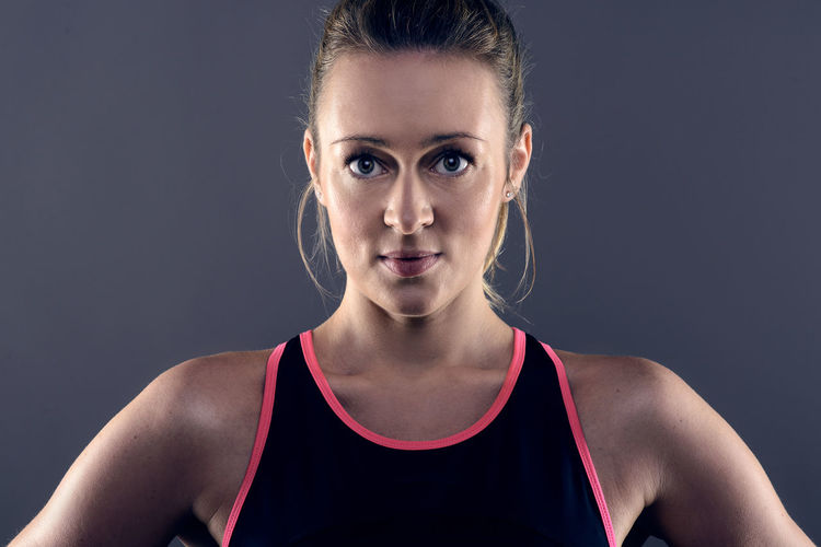 Portrait of athlete against gray background