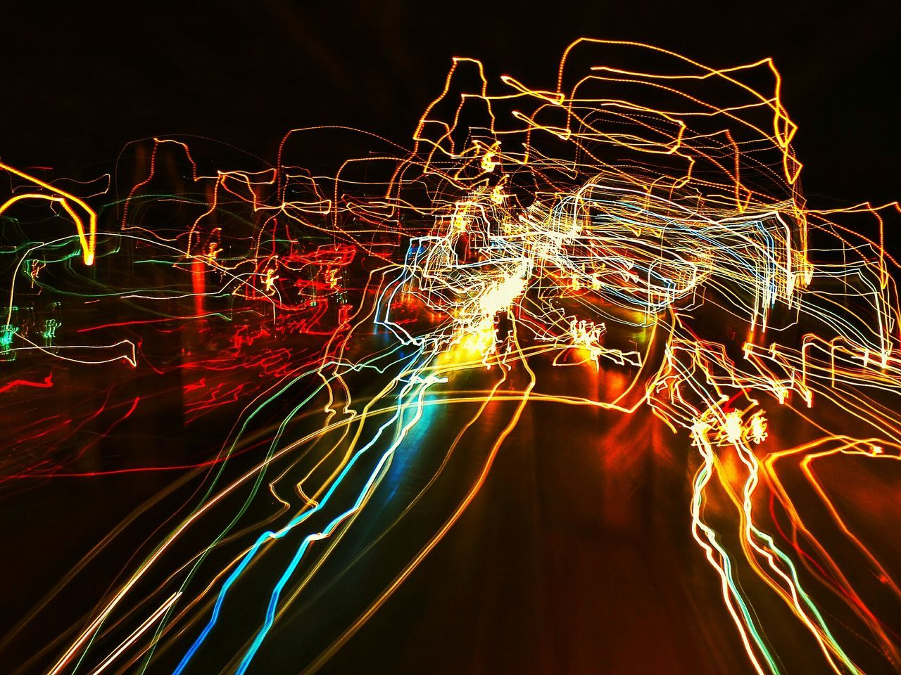 long exposure, night, illuminated, light trail, glowing, light painting, motion, speed, blurred motion, no people, multi colored, abstract, electricity, pattern, outdoors, technology, wire wool, black background, close-up, sky