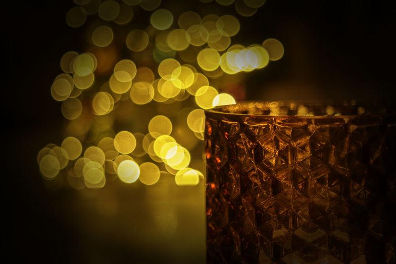 Close-up of illuminated lights at night