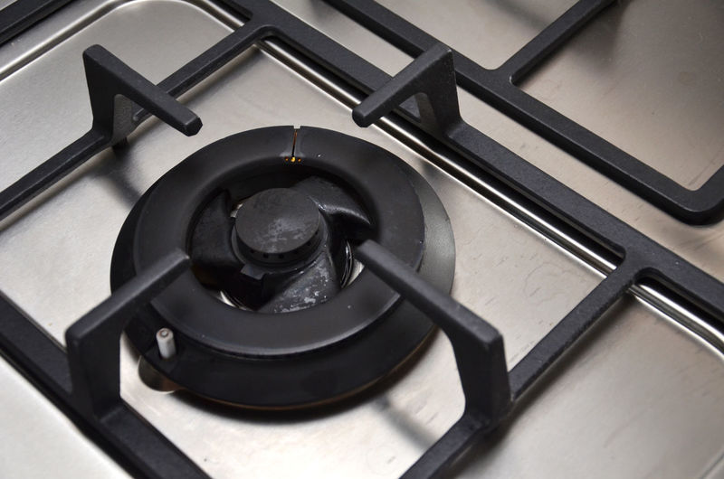 Close-Up Of Gas Stove Burner In Kitchen