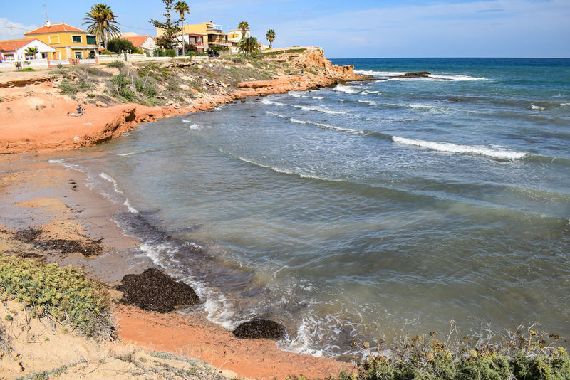 A bay Waves Mediterranean  SPAIN Red Cliffs Water Wave Sea Beach Sand Sky Horizon Over Water Architecture Landscape Rocky Coastline Rock Formation Coastline Rock Physical Geography Coast Boulder Crashing Stack Rock Cliff Rugged View Into Land Geology Surf Eroded Seascape Rushing