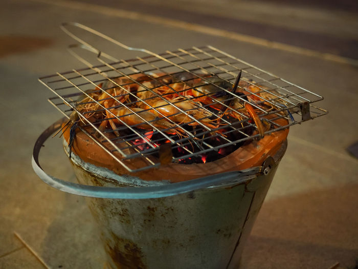 High Angle View Of Prawns On Barbecue Grill