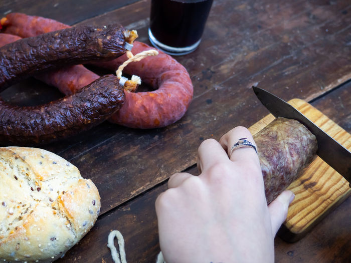 Close-up of hand holding food on table