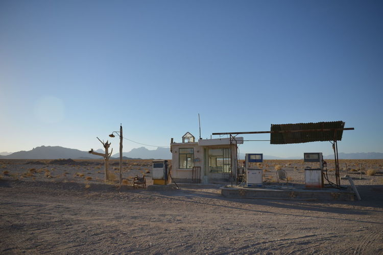 Gas Station At Desert Against Clear Blue Sky