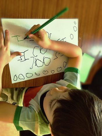 Paper Human Hand Table Indoors  Holding One Person Childhood Real People Handwriting  Drawing - Art Product Close-up Child Boy Young Writing Write Sitting Seated Sat Down Handwriting Practice