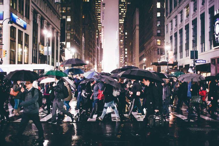 Crowd on wet street during rainy season at night