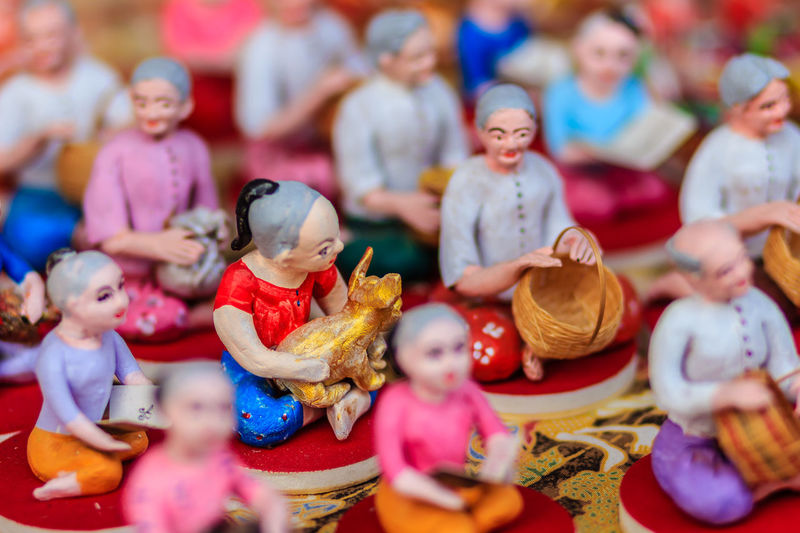 Cute Clay Dolls of Thai Culture, Selective Focus Clay Doll Doll Cute Clay Dolls Thai Doll Art And Craft Childhood Choice Clay Doll Clay Dolls Close-up Creativity Day Female Likeness Figurine  Human Representation Indoors  Male Likeness Multi Colored No People Sculpture Statue Thai Children Thai Cultural Thai Culture Variation
