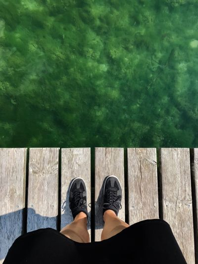 Standing on the pier and wandering - water, is it cold? Waterfront Feet ınstagram Instaphoto Black Skirt Skirt Black Sneakers Wood - Material Wooden Dock Dock Emerald Lake Green Lake Low Section Human Leg Body Part Real People Lifestyles Personal Perspective Human Body Part Standing Leisure Activity One Person Nature Shoe Water Women Human Foot Outdoors Adult High Angle View The Fashion Photographer - 2018 EyeEm Awards The Still Life Photographer - 2018 EyeEm Awards EyeEmNewHere The Traveler - 2018 EyeEm Awards