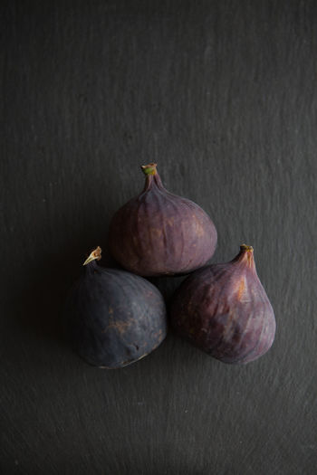 Fresh fruits, figs on a white background top view Food And Drink Wellbeing Food Healthy Eating Studio Shot Indoors  Still Life Fruit Freshness Fig No People Close-up Table Group Of Objects High Angle View Black Background Wood - Material Gray Ripe Three Objects Purple Crockery