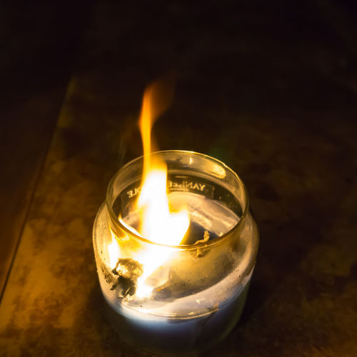 Candle burning in a glass jar on a wooden table Burning Candle Design Fire Fire - Natural Phenomenon Flame Glass Glowing Heat - Temperature Home Hot Illuminated Indoors  Jar No People Oil Lamp Single Object Studio Shot Sweet Home Table Tea Light Warm Wood Wood - Material Yankee