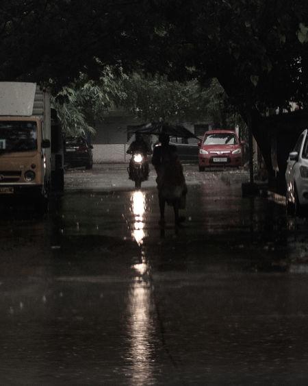 Cars on wet street during rainy season