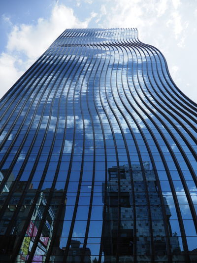 Architecture Curve Glass - Material Blue Outdoors Reflections Façade Outdoor Photography Daylight Tourism Travel Photography Building Exterior City Modern Skyscraper Urban Skyline Business Finance And Industry Cityscape Roof Office Steel Sky Office Building Exterior Tall - High Office Building Financial District  High Rise Tower Downtown District Skyline