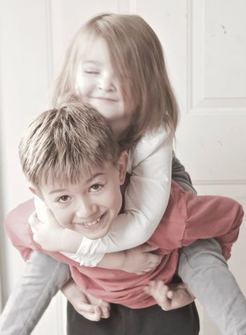 Loving the good times Happy Having Fun Kids Little Sisters Baby Sister Baby Sitting Big Brothers Boy Childhood Children Playing Cute Family Concepts And Topics Girl Hugs Kindness Matters Little Love Piggy Back Ride  Playing Raising Happy Children Sibling Sibling Relationships Smiling Togetherness White Background