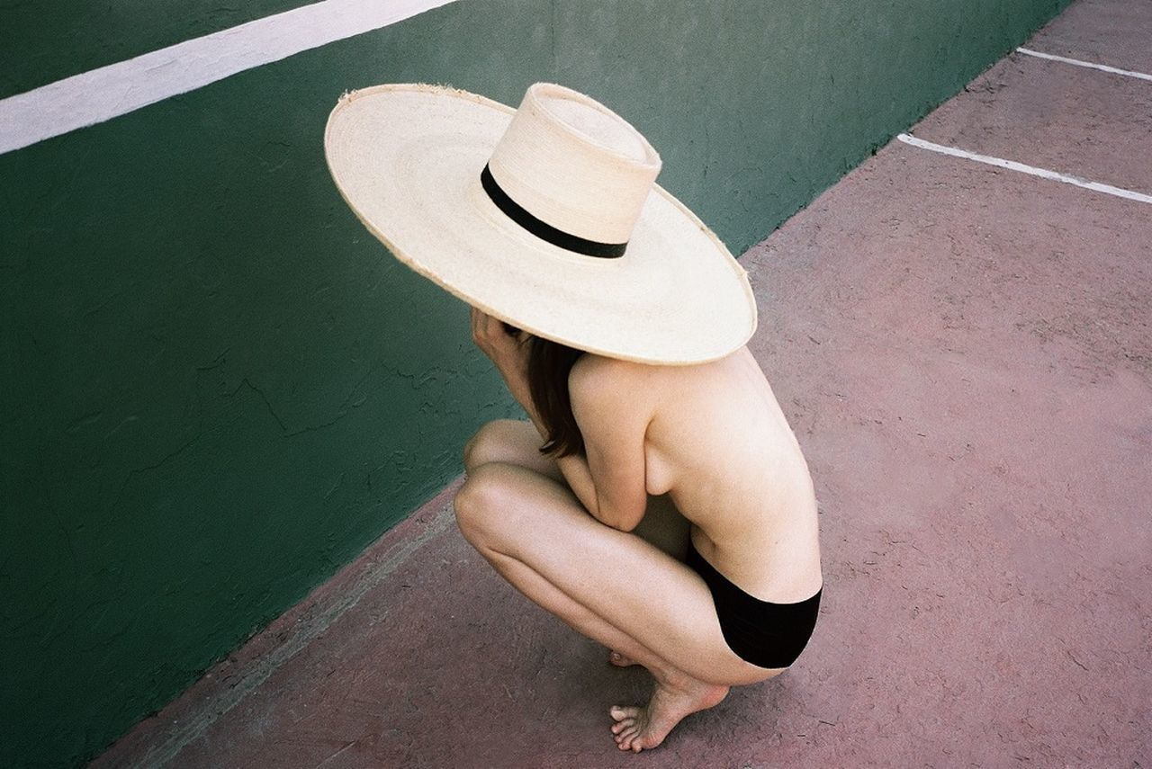 HIGH ANGLE VIEW OF A PERSON WEARING HAT