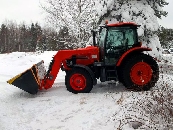 A tractor in a snowy field. Bare Tree Cold Temperature Day Farm Farm Equipment Farm Life Field Front End Loader Frozen Nature No People Orange Outdoors Snow Snow Covered Trees Snowing Snowy Field Tractor Tree Weather Winter Winter Scene