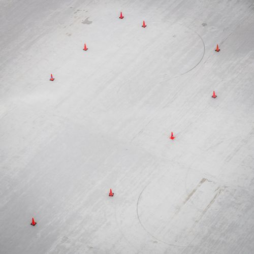 High Angle View Of Traffic Cones On Snow Covered Field